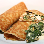Crepes filled with spinach and salmon